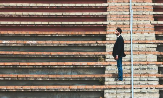 man standing sideways on steps