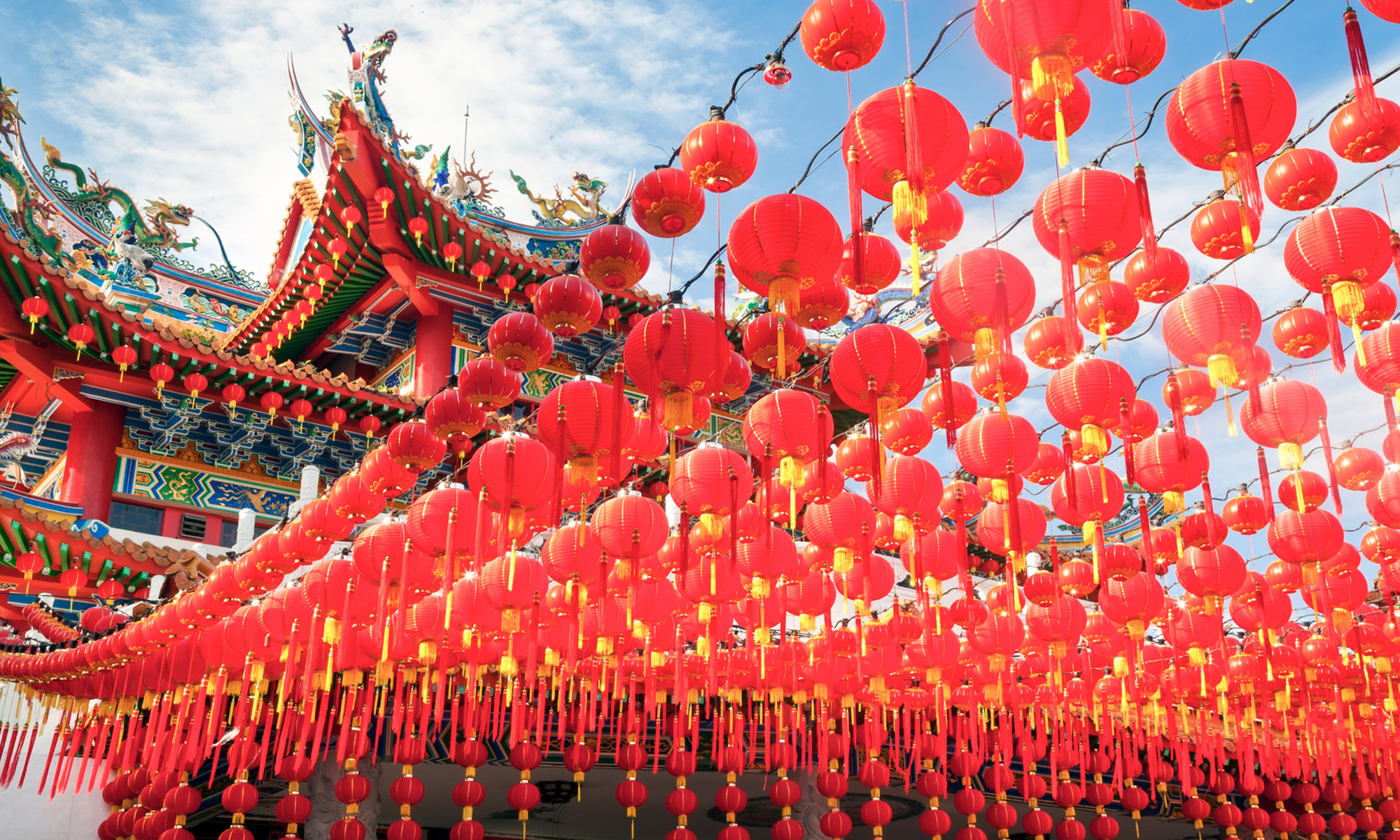 display of Chinese lanterns against temple