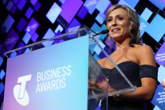 Dietitian and exercise physiologist, Kate Save accepts the 2018 Telstra Victorian Business of the Year Award for healthy eating disruptor Be Fit Food.