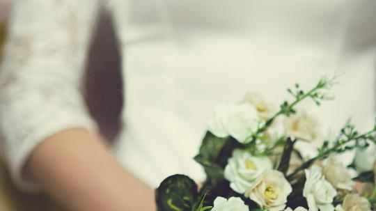 A bride holds a bouquet of flowers on her special day