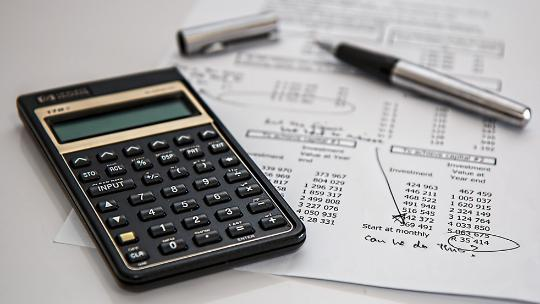 Calculator and pen on financial statement