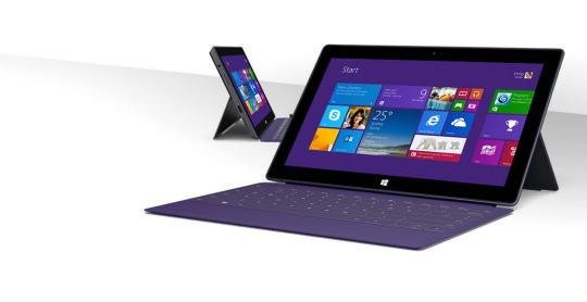 Two Microsoft Surface Pros - one in foreground, one in background