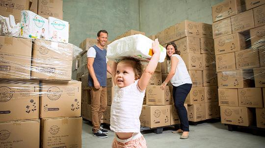 baby in factory with boxes