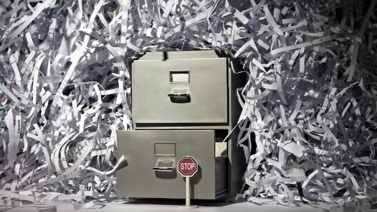 filing cabinet surrounded by shredded paper