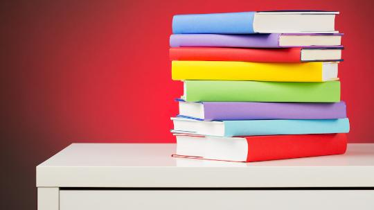 Colourful books stacked on a table