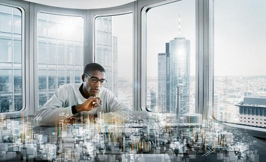 Man looking over futuristic city