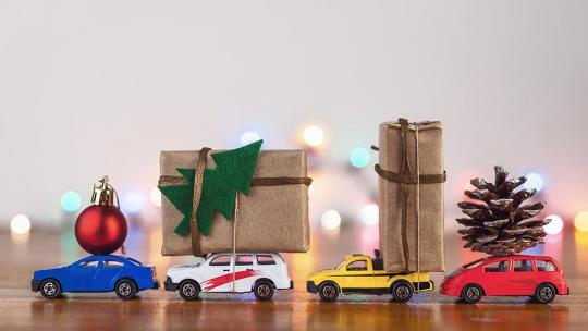 Toy cars with christmas decorations and presents on their roof