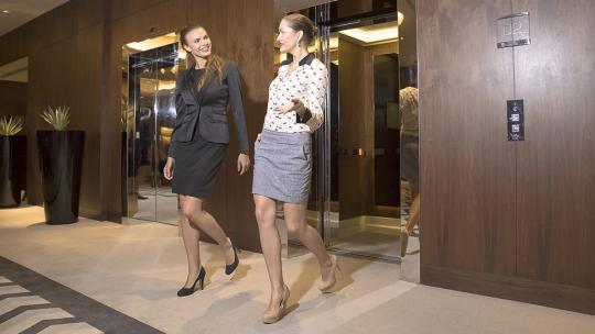 Women walking out of a lift