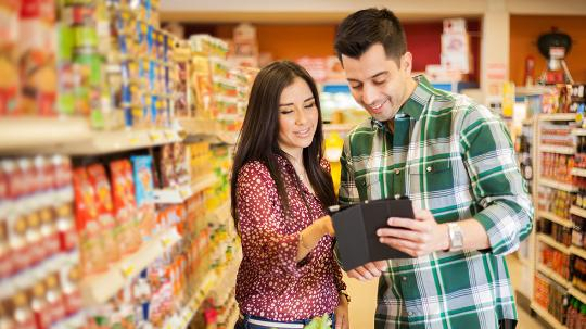 Man and woman shopping with tablet