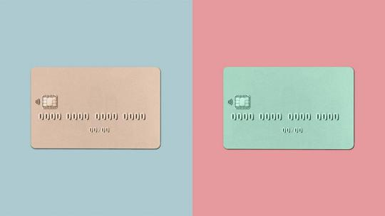 Two credit cards sit side by side
