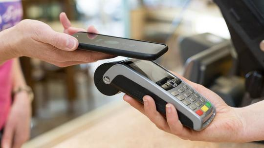 Person using EFTPOS terminal with their smartphone