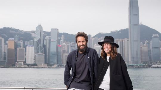 Erin Deering and partner Craig standing in front of the Hong Kong skyline