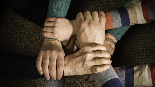 Hands stacked on one another