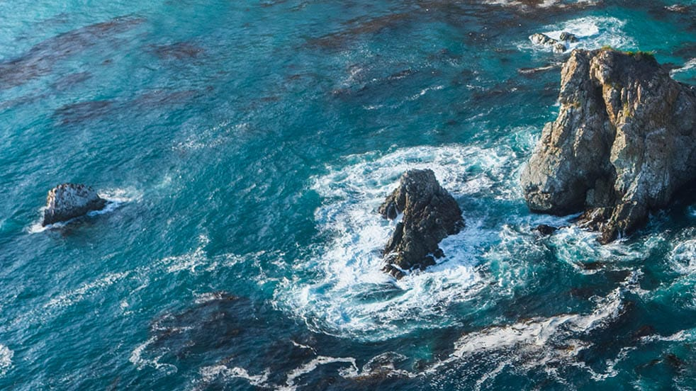 tidal waters swirling around rocky outcroppings