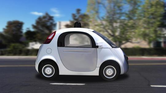 A small smart car drives on a clear day to the right of the photo