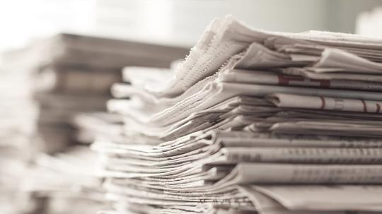 a stack of newspapers close up