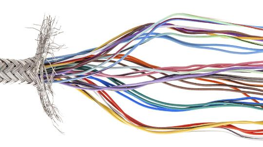 A close up of multicoloured frayed wires.