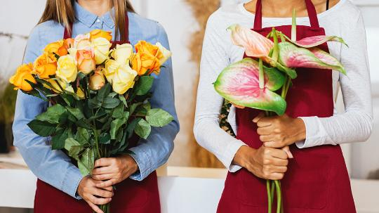 a close up photo of two florists holding flowers