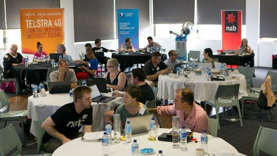 A wide shot of a full room at the neto ecommerce bootcamp