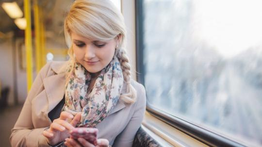 Woman on mobile phone on train