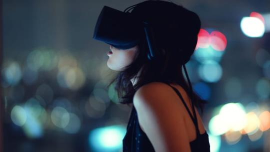 Girl looking through virtual reality headset