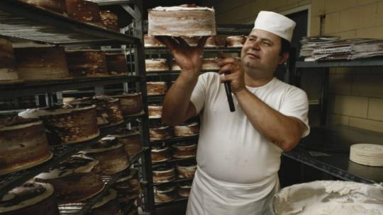 A baker working in a bakery.