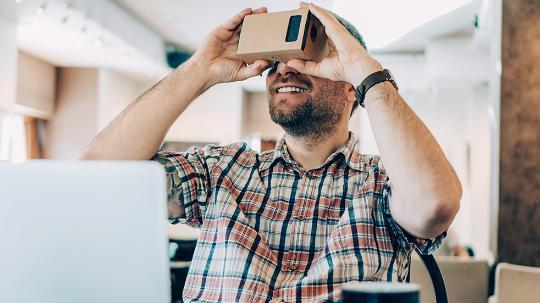 man with cardboard VR headset