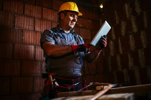 Construction man on tablet
