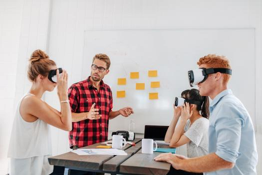 Image shows a business meeting using VR technology.