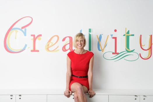 Image shows ADMA CEO Jodie Sangster sitting in front of a sign that says 'Creativity'.