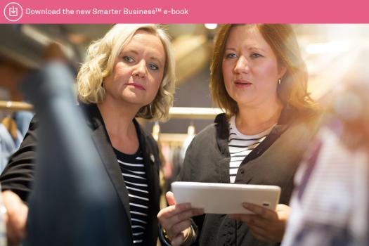Cargo Crew Founder Felicity Rodgers and Client Services Director Narelle Craig looking at a tablet screen and products.