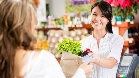 woman at checkout of grocery store