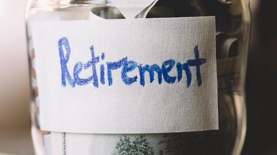 Money jar with retirement label attached