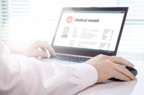 Medical record appears on laptop