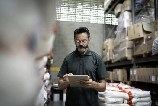 Man using tablet in stockroom