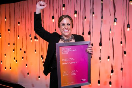Belinda Tumbers holding her Telstra Business Women's Award in 2017.